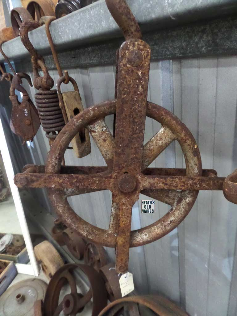 Industrial antique pulley for sale at Heaths Old Wares, Collectables, Antiques & Industrial Antiques, 19-21 Broadway, Burringbar NSW 2483 Ph 0266771181 open 7 days