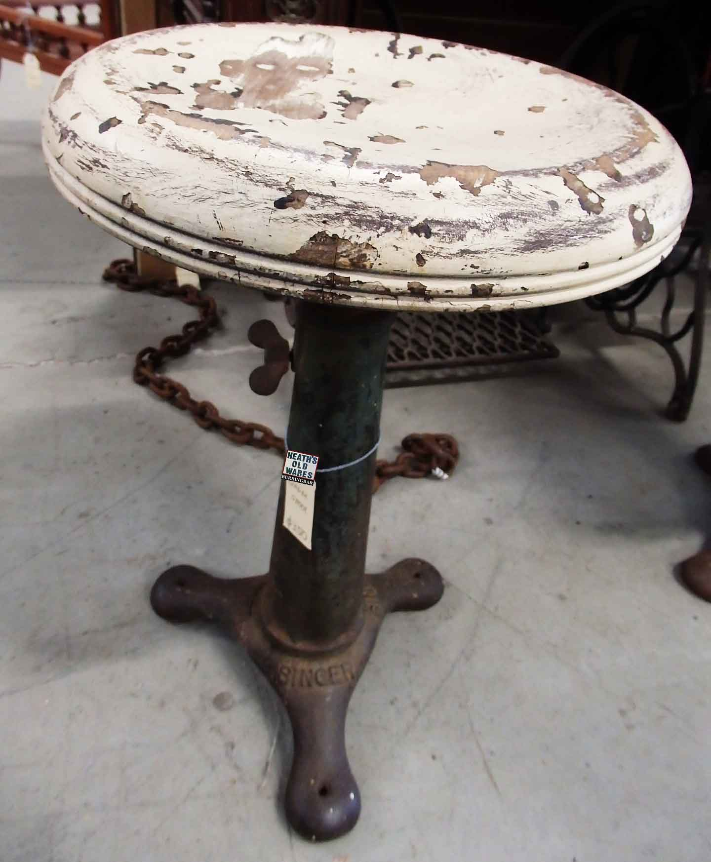 Singer Sewing Machine Stool, cast iron base, impressed with the SINGER brand $350 for sale at Heaths Old Wares, Collectables, Antiques & Industrial Antiques, 19-21 Broadway, Burringbar NSW 2483 Ph 0266771181 open 7 days