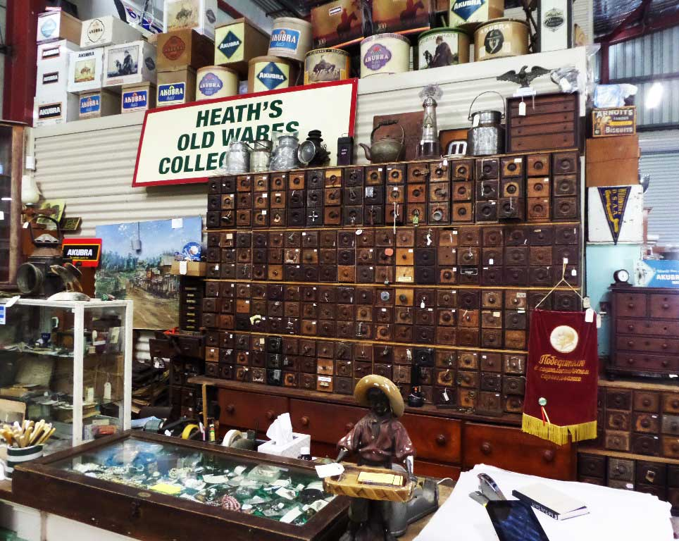 Heath's Old Wares Spare parts apothecary stored in all of these beautiful singer sewing machine drawers